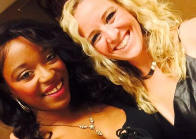 smiling faces of two women singers